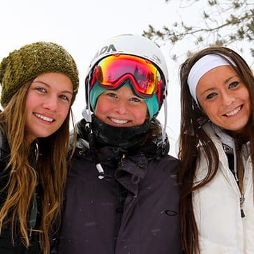 Three women smiling during winter